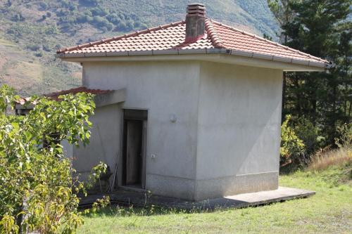 Hus på landet i Papasidero