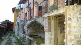 Hus i Mignanego